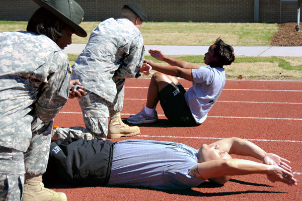 Army PT on a track.