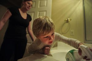 Heather Drain and son cleaning the sink.