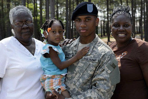 Soldier with family in woods.