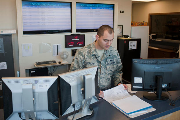 Airman 1st Class Jourdan Sutton, 99th Logistics Readiness Squadron air terminal operator, checks the flight schedule at the air terminal on Nellis Air Force Base, Nev., May 26, 2015. (Photo: U.S. Air Force)