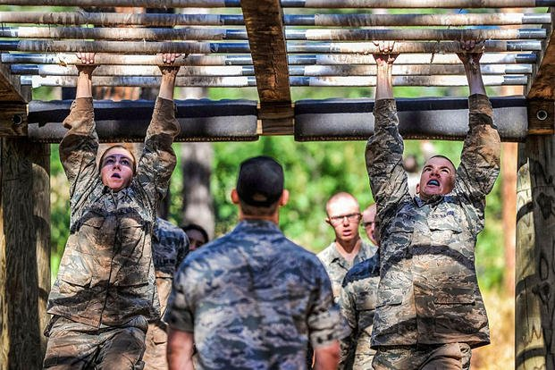 Basic cadets navigate the monkey bars on the obstacle course in the U.S. Air Force Academy's Jacks Valley during the field portion of their Basis Cadet Training July 22, 2015, in Colorado Springs, Colo. Liz Copan/U.S. Air Force