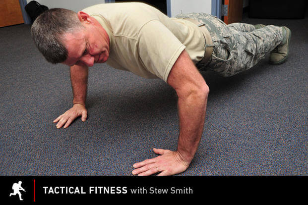Tactical Fitness: Airman in pushup contest.