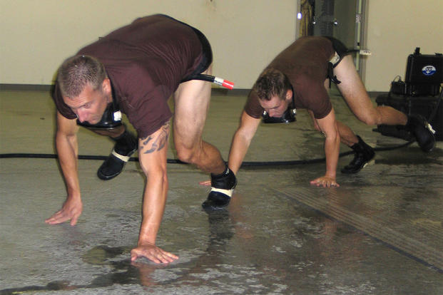 Candidates for the combat rescue officer selection program train for the water confidence portion with a bear crawl. (U.S. Air Force photo/Staff Sgt. Connie L. Bias)