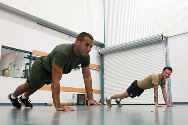 A member of 3rd Battalion, 3rd Marine Regiment, Marine Rotational Force-Darwin and an Australian Army classmate complete moving pushups during a physical training session. (Photo: U.S. Marine Corps)