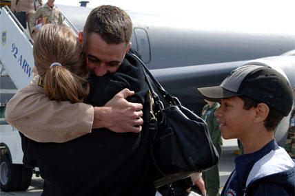 airman hugs wife