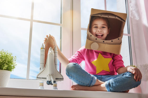 Girl with space shuttle toy