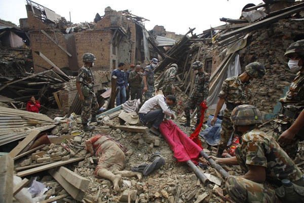 A dead body of a woman is seen after rescue workers recovered it from debris following Saturday's earthquake in Bhaktapur near Kathmandu, Nepal, Sunday, April 26, 2015. Niranjan Shrestha/AP