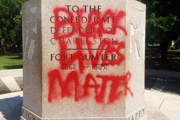 "This June 21, 2015, file photo shows a statue memorializing the Confederacy spray-painted with the message ""Black Lives Matter"" in Charleston, S.C. AP Photo/WCSC-TV, Philip Weiss"