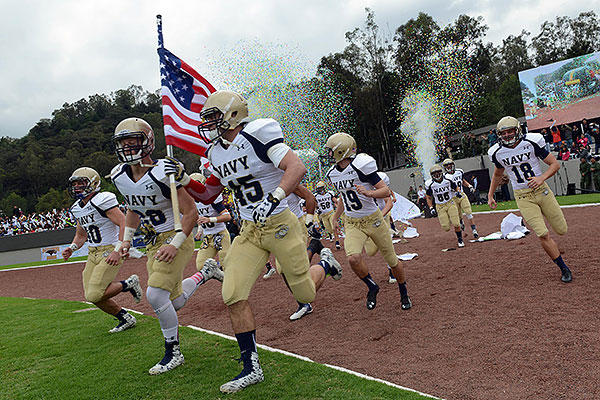 Midshipmen with the United States Naval Academy's Sprint football team rush out to the field at the Mexican Sedena Heroico Colegio Militar for an exhibition game with their Mexican counterparts in Mexico City, Mexico. (DoD photo by Lisa Ferdinando)
