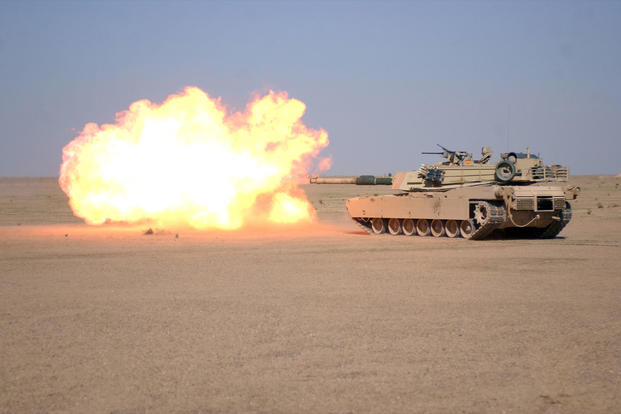 An M1A1 Abrams fires its main gun. (Photo: U.S. Army)