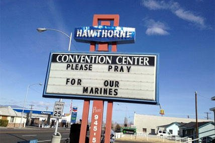 A Convention Center billboard asks people to pray for the Marines that will killed in Hawthorne, Nev. on Tuesday March 19, 2013.