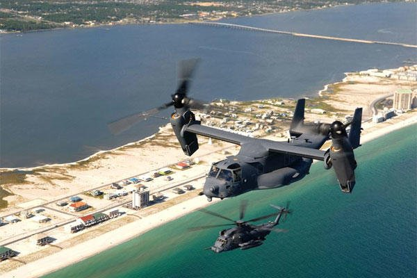 A CV-22 Osprey from the 8th Special Operations Squadron and an MH-53 Pave Low 20th Special Operations Squadron, fly over the coastline near Hurlburt Field, Fla. (U.S. Air Force photo/ Senior Airman Julianne Showalter)