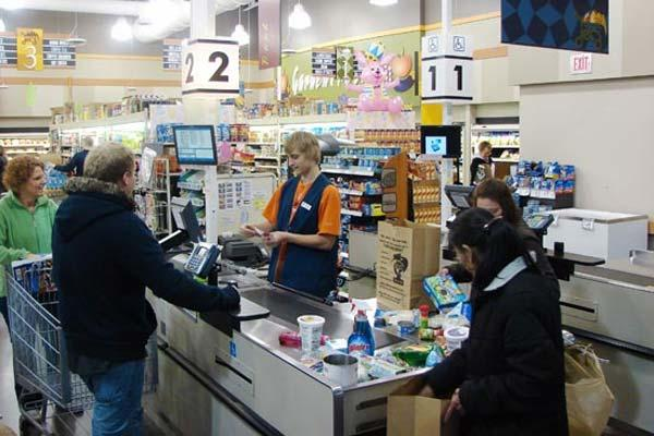 Authorized patrons at the Fort McCoy Commissary check out their grocery items. (Photo by Geneve N. Mankel)