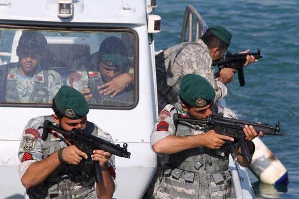 Iranian navy members take positions during a drill in the Sea of Oman, Wednesday, Dec. 28, 2011. (Photos: Ali Mohammadi/AP)