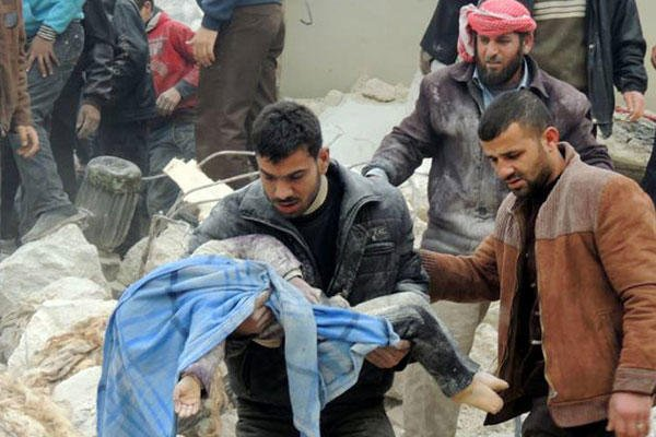 This citizen journalism image taken on Tuesday, Feb. 19, 2013 and provided by Aleppo Media Center AMC, shows a Syrian man carrying a girl's body in the aftermath of a strike by Syrian government, in the neighborhood of Jabal Bedro, in Aleppo, Syria.