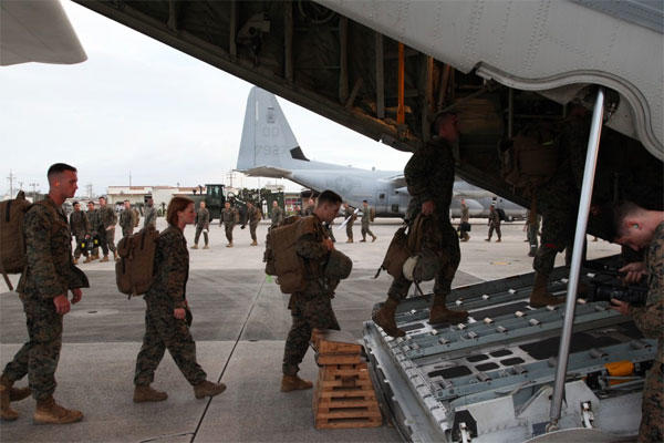 Marines board a KC-130J Hercules aircraft Nov. 10 at Marine Corps Air Station Futenma, Okinawa, Japan, moments before departing for a humanitarian assistance and disaster relief mission to the Philippines.