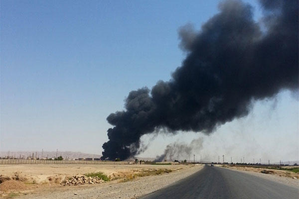 A column of smoke rises from Beiji oil refinery, some 250 kilometers (155 miles) north of Baghdad, Iraq, Thursday, June 19, 2014. (Associated Press)