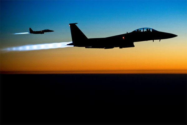 A pair of U.S. Air Force F-15E Strike Eagles fly over northern Iraq after conducting airstrikes against Islamic State of Iraq and the Levant targets targets in Syria, Sept. 23, 2014. (Photo: DoD)