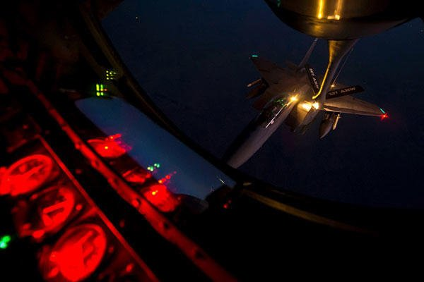 A U.S. Air Force F-15E Strike Eagle receives fuel from a KC-135 Stratotanker over northern Iraq after conducting airstrikes in Syria, Sept. 23, 2014. Matthew Bruch/Air Force