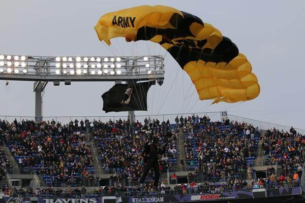 The Army Golden Knights and the Navy Leap Frogs parachuted into the stadium before the game. (Military.com/Steve Whitman)