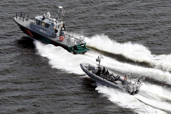 Boats of the Finnish Border Guard patrol the waters outside Helsinki Tuesday, April 28, 2015 (Jussi Nukari/LEHTIKUVA via AP