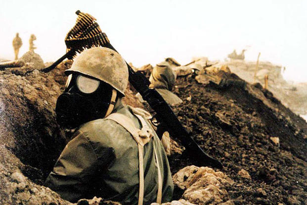 Iranian soldier with gas mask during Iraq-Iran Civil War. Photo courtesy of Joseph V. Micallef