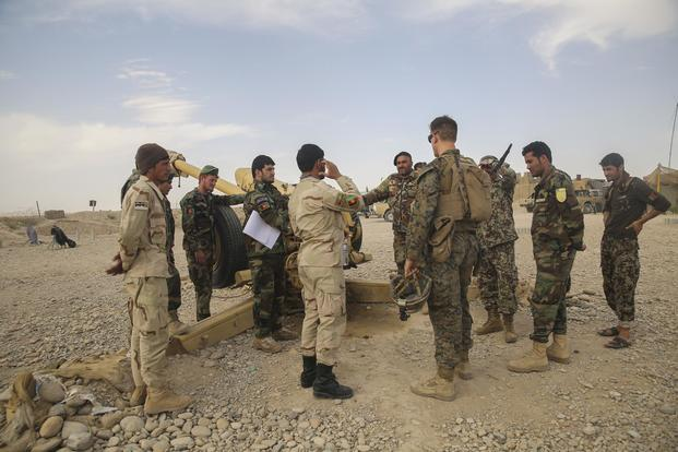 A U.S. Marine adviser with Task Force Southwest speaks with Afghan National Army soldiers with the 2nd Brigade, 215th Corps, on artillery capabilities and tactics at Camp Nolay, Afghanistan, on May 22, 2017. Sgt. Lucas Hopkins/Marine Corps