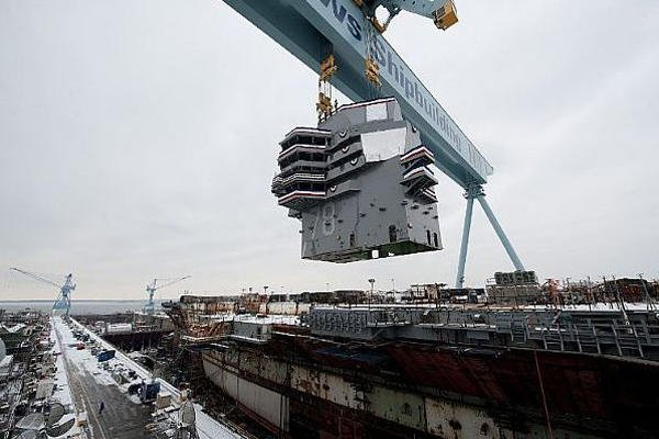 The 555-metric ton island is lowered onto the nuclear-powered aircraft carrier Gerald R. Ford (CVN 78)on Jan. 26, 2013 at Newport News, Va. Navy photo courtesy of Huntington Ingalls Industries.