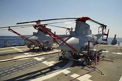 This Navy photo shows two of four Northrop Grumman MQ-8B tactical unmanned aerial vehicles aboard USS Klakring last June. The Navy will soon stand up its first drone squadron.