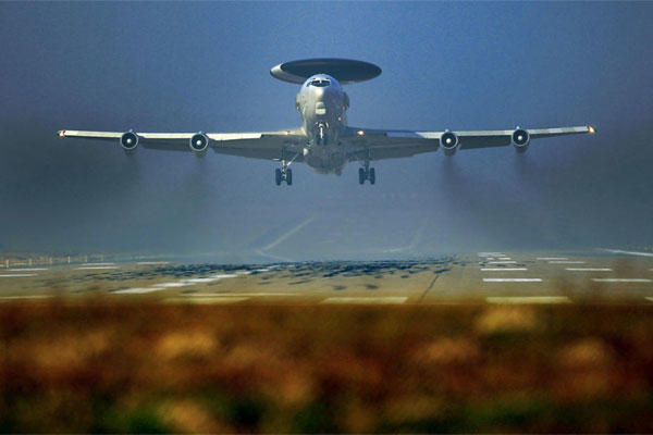A Nato AWACS plane takes off the NATO Airbase in Geilenkirchen, Germany, Wednesday, March 12, 2014. (AP Photo/Frank Augstein)