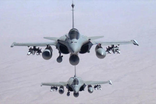 This remote camera screen grab photo provided Friday, Sept.19, 2014 by the French Army's video and photo department ECPAD shows two Rafale jet fighters fly over Iraq Friday. (AP Photo/ECPAD)