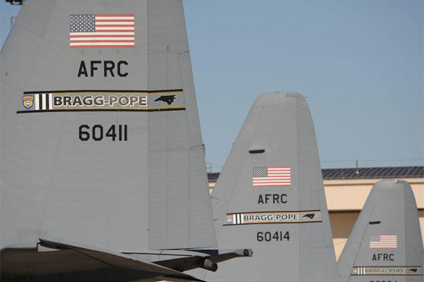 The C-130 Hercules aircraft prominently displays the Bragg-Pope tail flashing of the 440th Airlift Wing at Pope Air Force Base, N.C. On March 1, 2011 the former air force base was called Pope Field. (U.S. Air Force photo by Staff Sgt. Peter R. Miller)