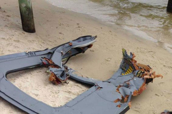 Part of a door assembly of what could be the wreckage of a UH-60 Black Hawk helicopter sits on Riviera Beach in Navarre, Fla., Wednesday, March, 11, 2015. (AP Photo/Northwest Florida Daily News, Jennie McKeon)