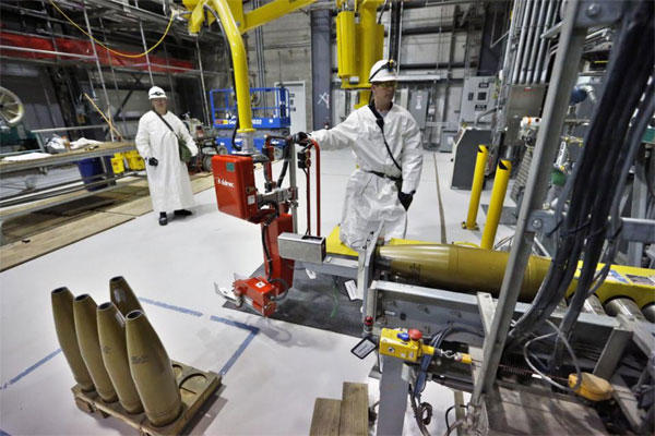 Ordinance technicians use machines to  process inert simulated chemical munitions used for training at the Pueblo Chemical Depot  in Colorado. (AP Photo/Brennan Linsley, file)