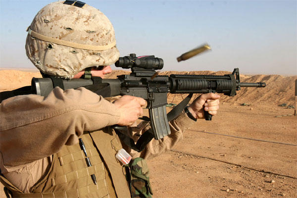 Sergeant Christopher L. McCabe fires his rifle during monthly range training (Marines/Corporal Thomas J. Griffith)