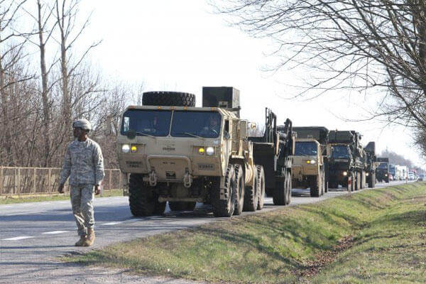 A column of military vehicles carrying a Patriot missile system, from Delta Battery, 5th Battalion, 7th Air Defense Artillery Regiment, arrives for a training exercise at Sochaczew, Poland, March 18, 2015. (U.S. Army photo: Sgt. 1st Class Randall Jackson)
