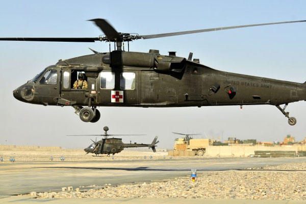 An Army HH-60 Black Hawk MEDEVAC helicopter from C Company, 3rd Battalion, 25th Aviation Regiment, 25th CAB heads off for another mission on Kandahar Airfield, Afghanistan.