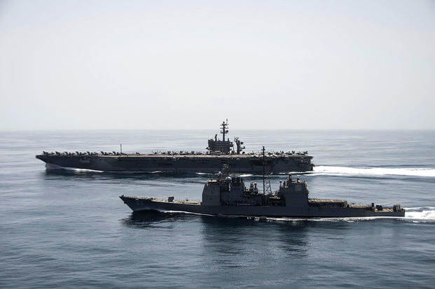 The aircraft carrier USS Theodore Roosevelt (CVN 71) and the guided-missile cruiser USS Normandy (CG 60) operate in the Arabian Sea conducting maritime security operations.