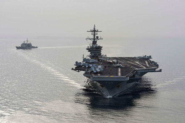 The aircraft carrier USS Theodore Roosevelt (CVN 71) and the guided-missile cruiser USS Normandy (CG) 60 sail in the U.S. 5th Fleet area of operations supporting Operation Inherent Resolve. (U.S. Navy/Mass Communication Specialist Seaman Anna Van Nuys)