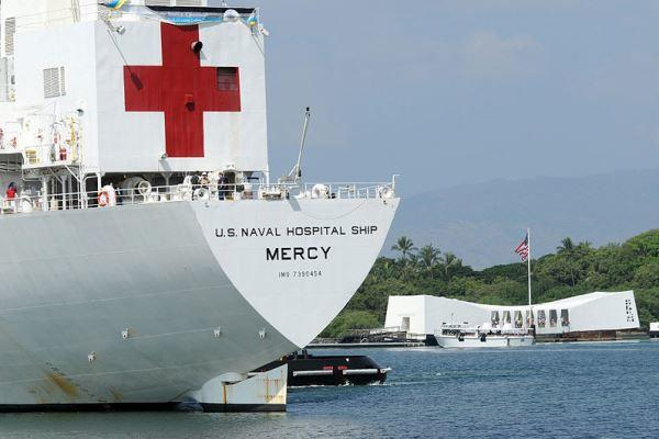 Naval hospital ship USNS Mercy sails by the USS Arizona Memorial in Pearl Harbor. (U.S. Navy photo)