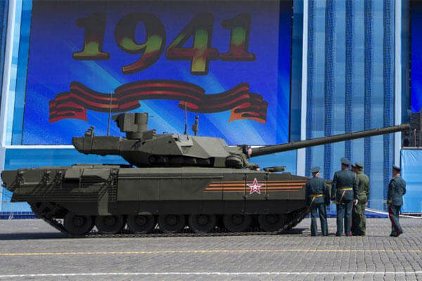 Russian officers discuss a situation with a crew member of the Russian T-14 Armata tank at Red Square during a preparation for a rehearsal for the Victory Day military parade in Moscow, Russia, Thursday, May 7, 2015.(AP Photo/Alexander Zemlianichenko)
