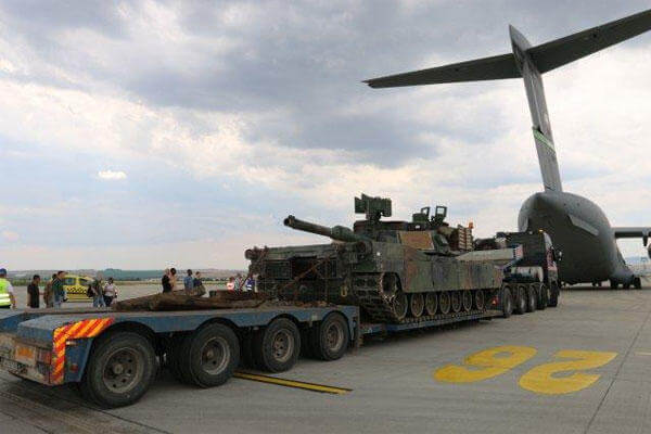 An M1A2 Abrams tank unloads from a C-17, Burgas, Bulgaria, June 20, 2015. (U.S. Army photo by Spc. Jacqueline Dowland)
