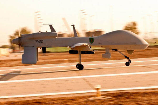 An MQ-1C Gray Eagle unmanned aircraft makes its way down an airfield at Camp Taji, Iraq, before a surveillance mission in the Baghdad area, in this undated file photo. (U.S. Army photo)