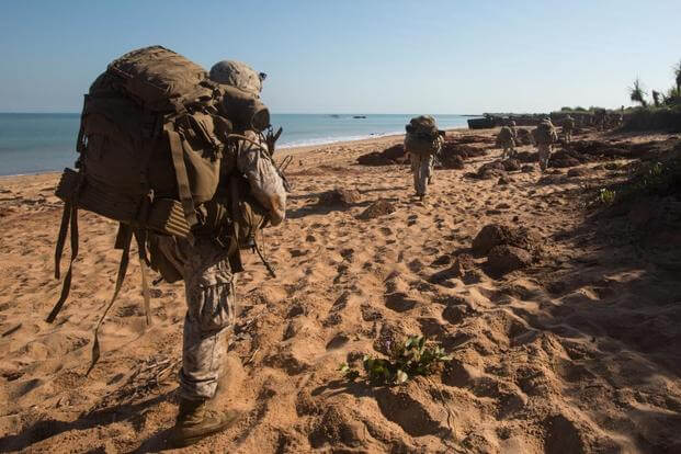 Marines begin to patrol inland to secure secondary objectives following an July 11 amphibious assault training exercise at Fog Bay, Australia. Marines.mil.