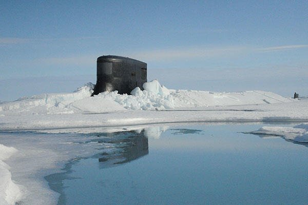 The fast attack submarine USS Seawolf (SSN 21) surfaces through Arctic ice at the North Pole. Seawolf conducted routine Arctic operations. (U.S. Navy)