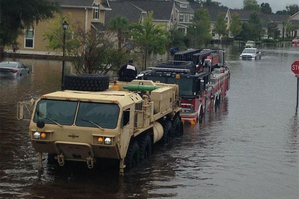South Carolina National Guardsmen with the 108th Chemical Company and the 1118th Forward Support Company assist with a fire truck stuck in high water in Charleston, S.C., Oct. 4, 2015. (South Carolina Army National Guard photo by Capt. Brian Hare)