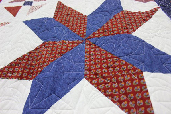 Many of the quilts to be given to veterans through the Quilts of Valor feature a star design, such as this red and blue star. (U.S. Army photo/ Kari Hawkins)