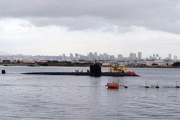 The Los Angeles-class fast-attack submarine USS Albuquerque (SSN 706) departs San Diego for the final time. Albuquerque held an inactivation ceremony Oct. 16 at Naval Base Point Loma. (U.S. Navy/MC2 Kyle Carlstrom)