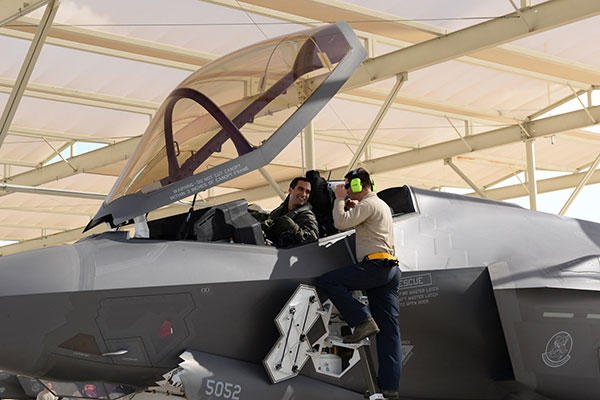 An Italian F-35 Lightning II pilot is met by a 61st Aircraft Maintenance Unit Airman Nov. 5, 2015, at Luke Air Force Base, Ariz., after the pilot flew the first Italian F-35 training mission. (U.S. Air Force/Airman 1st Class Ridge Shan)