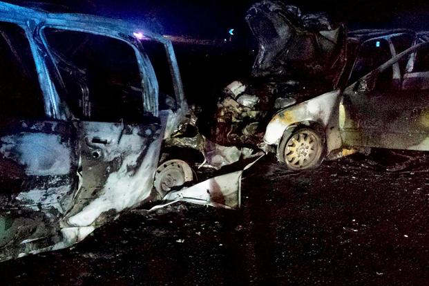 What is left of two cars after an accident on May 12, 2014, near Royal Air Force Mildenhall, England. Ssgt Vicente Gomez performed life-saving assistance to the crash victims. Gomez was presented with the Airman's Medal for his acts. (Courtesy photo)